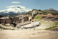 The Ancient theatre of Taormina and Mount Volcano Etna snowy. The Ancient theatre of Taormina (Teatro antico di Taormina in italian language) is an ancient Greek royalty free stock photo