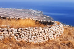 Ancient Thera ruins overlooking Santorini airport Stock Image