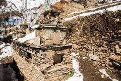 Ancient Tibetan Buddhist chorten in Upper Pisang Village in the Annapurna region, Nepal, Manang district stock images