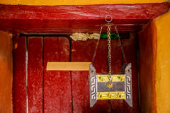 Ancient Tibetan incense tools in Buddhist temple against red wood door stock images