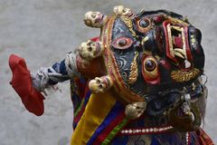 An ancient Tibetan sacral mask for a ritual Buddhist ceremony. Royalty Free Stock Images