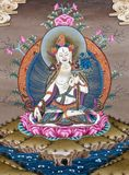 Ancient Tibetan tangka. Ancient art of tibetan tangka - a painted Buddhist banner with White Tara Goddes Royalty Free Stock Photography