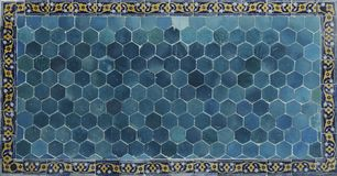 Ancient tile. Ceramic wall in Bukhara. Islamic ceramic decor. On wall royalty free stock images