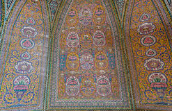 Ancient tiles with Persian patterns inside the mosque Nasir ol Molk, Isfahan. Traditional artworks Royalty Free Stock Image