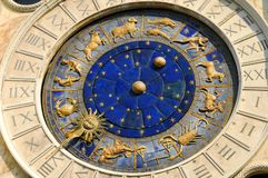 Ancient time, Astrology and Horoscope. Detail of Saint Mark Square old Clocktower with zodiac signs, planets and stars 15th century royalty free stock photography
