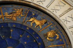 Ancient time, Astrology and Horoscope. Ancient time and Astrology. Detail of Saint Mark Square renaissance Clock Tower in Venice with zodiac signs Leo, Cancer stock images