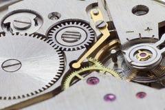 Ancient tiny metal clockwork close up. The ancient tiny metal clockwork close up Royalty Free Stock Images