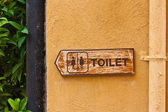 Ancient toilet sign stock image