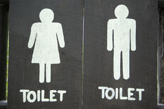Ancient toilet sign on wood Royalty Free Stock Photo