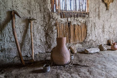 Ancient Toоl. Ancient tool for agriculture in old reed house Royalty Free Stock Images
