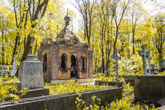 Ancient tomb in the autumn forest. The ancient cemetery of St. Petersburg (Novodevichy cemetery). The crypt, which is designed in the antique style royalty free stock photos