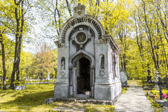 Ancient tomb in the autumn forest. The ancient cemetery of St. Petersburg (Novodevichy cemetery). The crypt, which is designed in the antique style Stock Image