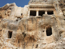 Ancient tomb cave of Bnei Hezir in Jerusalem. The Tomb of Benei Hezir (Hazir) is the oldest of four monumental rock-cut tombs that stand in the Kidron Valley Royalty Free Stock Photo