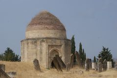 Ancient tomb in a cemetary the Absheron Peninsula, Azerbaijan. This ancient tomb and gravestones were found in a cemetary in the Abseron Peninsula in Azerbaijan royalty free stock photography