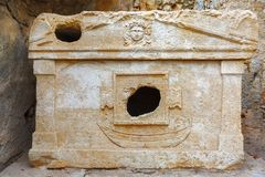 Ancient tomb with relief, crypt, Olympus, Lycia. The ancient burial place of the Greek civilization. On the tomb there is an image of a man and a boat. And Stock Images