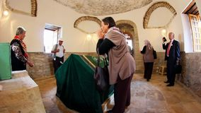 Ancient tomb of Sari Saltik Baba. BABADAG,DOBRUJA/ROMANIA - SEPTEMBER 07:Turks from the Balkans in pilgrimage to the tomb of Sari Saltik Baba on September 07 stock video footage
