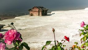 Ancient tomb submerged in a travertine pool at Hierapolis hot springs, Pamukkale, Turkey. 4k. Ancient tomb surrounded by white limestone in a travertine pool at stock footage