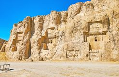 Ancient tombs in Naqsh-e Rustam, Iran. The ancient tombs of Achaemenid dynasty Kings of Persia are carved in rocky cliff in Naqsh-e Rustam, Iran Royalty Free Stock Photography