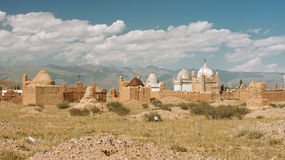 Ancient tombs and gravestones of Muslim cemetery a. Panorama with ancient tombs and gravestones of Muslim cemetery and mountains background Royalty Free Stock Photo