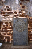 Ancient Tombstone at Church Ruins. An ancient 17th century Dutch tombstone found at the ruins of St. Paul's Church, originally built by the Portuguese in 1521 at Royalty Free Stock Photos
