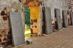 Ancient tombstones at church ruins Royalty Free Stock Photos