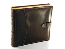 An ancient tome bound in leather. Stock Photo