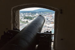 Ancient top gun with view over Salzburg from fortress Hohensalzburg Stock Images
