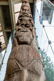Ancient Totem Pole Rising into Glass Lobby Royalty Free Stock Images