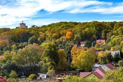 Ancient tower above the autumn forest royalty free stock photography