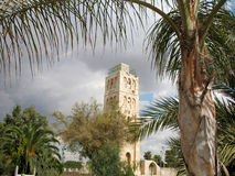 Ancient tower in Arabic style. On the background of vegetation , architecture of the ancient Stock Photography