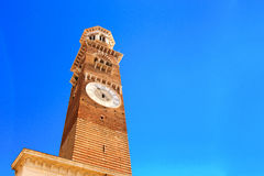 Ancient tower with clock on a sky background Stock Image