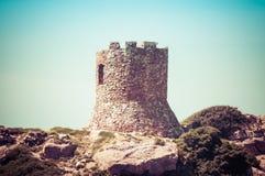 Ancient tower on the coast. Italy, nature, sardinia, sea, alghero, water, blue, porticciolo, summer, sardegna, mediterranean, sky, ocean, shore, green, rocks royalty free stock photo