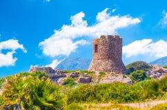 Ancient tower on the coast. Italy, nature, sardinia, sea, alghero, water, blue, porticciolo, summer, sardegna, mediterranean, sky, ocean, shore, green, rocks royalty free stock photography