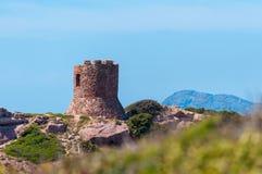 Ancient tower on the coast. Ancient tower on sardinian coast near Porticciolo, italy, nature, sea, alghero, water, blue, summer, sardegna, mediterranean, sky stock images