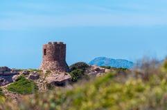 Ancient tower on the coast. Ancient tower on sardinian coast near Porticciolo, italy, nature, sea, alghero, water, blue, summer, sardegna, mediterranean, sky royalty free stock photography