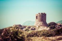 Ancient tower on the coast. Ancient tower on sardinian coast near Porticciolo, italy, nature, sea, alghero, water, blue, summer, sardegna, mediterranean, sky royalty free stock image