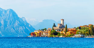 Ancient tower and colorful houses in malcesine old town. Ancient tower and fortress in old town malcesine at garda lake veneto region italy high snowbound top royalty free stock photo