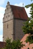 Ancient tower with the front of the roof in the form of stepped pyramid in the town of Dinkelsbuhl in Germany Stock Images
