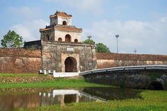 Ancient tower with gate of the fortress city of Hue. Vietnam Royalty Free Stock Image