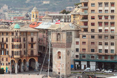 Ancient tower Guarda and city. Savona, Italy Stock Photos