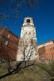 Ancient tower with hours. In the city center Royalty Free Stock Image