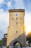 The ancient tower `Isartor` in Munich in Bavaria is one of four main gates of the medieval city wall Stock Photos