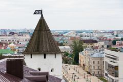 An ancient tower with a weather vane. On the background of a European city stock images