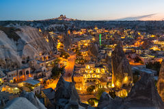 Ancient town and a castle of Uchisar dug from a mountains after twilight. Stock Photos
