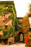 Ancient town of civita di bagnoregio in italy, house of flowers. Ancient town of civita di bagnoregio in italy, beautiful house of flowers royalty free stock images