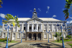 The ancient town hall of Fort-de-France and Aime Cesaire theater. Fort de France is Stock Photos