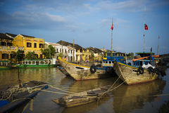 Ancient town viewed from the river with fisfingboats at foregrou Stock Photography