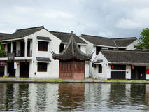 The ancient town of Xitang buildings. Ancient style buildings near a lake inside Xitang ancient town view Jiashan County jiaxing city zhejiang province China Stock Photo