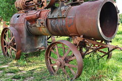 Ancient tractor. An very old agricultural machine Stock Photo