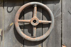 Ancient tractor steering wheel Stock Photos